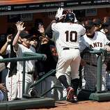 San Francisco Giants shortstop Miguel Tejada is greeted at the dugout after hitting a solo home run in the bottom of the third inning against the St. Louis Cardinals on Friday in San Francisco.