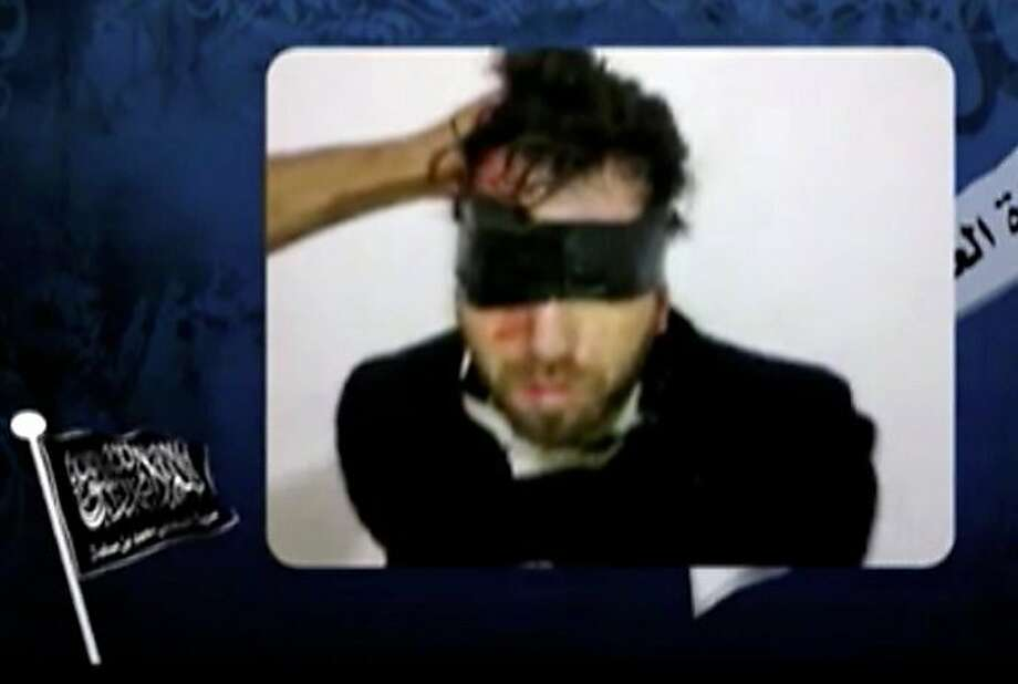 """EDITOR'S NOTE- RESTRICTED TO EDITORIAL USE - MANDATORY CREDIT """"AFP PHOTO / YOUTUBE.COM"""" - NO MARKETING NO ADVERTISING CAMPAIGNS - DISTRIBUTED AS A SERVICE TO CLIENTS A screengrab taken on April 14, 2011 from a video posted on YouTube shows an Italian activist kidnapped by a Salafist group of radical Islamists in Gaza. Foreign aid workers in the enclave named the man as Vittorio Arrigoni and said he was an activist with a pro-Palestinian group called the International Solidarity Movement (ISM), who was also working as a journalist and writer. The kidnappers identified themselves in the video as belonging to a previously unknown group called The Brigade of the Gallant Companion of the Prophet Mohammed bin Muslima. Photo: -, AFP/Getty Images"""