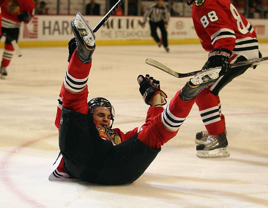 CHICAGO, IL - APRIL 10: Michael Frolik #67 of the Chicago Blackhawks slides across the ice after scoring a goal in the 2nd period against the Detroit Red Wings at the United Center on April 10, 2011 in Chicago, Illinois. Photo: Jonathan Daniel, Getty Images