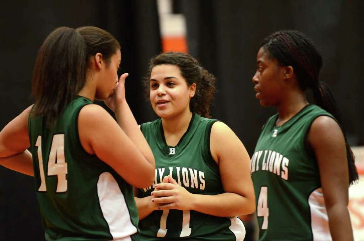 Bassick's Ashley Nunez (11) gives teammate Kayla Ponder (14) a pep talk as Monica Amazan (4) looks on during the season opener girls basketball game against Stamford at Stamford High School on Wednesday, Dec. 7, 2011.