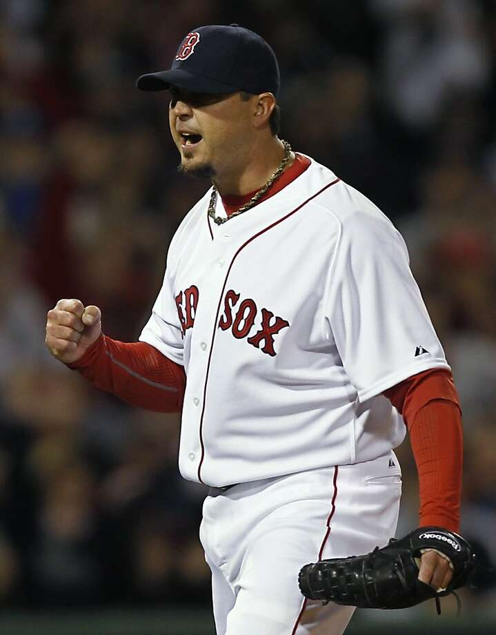 Boston Red Sox starting pitcher Josh Beckett pumps his fist after the Red Sox turned a double play against the New York Yankees during the third inning of a baseball game at Fenway Park in Boston on Sunday, April 10, 2011. Photo: Winslow Townson, AP