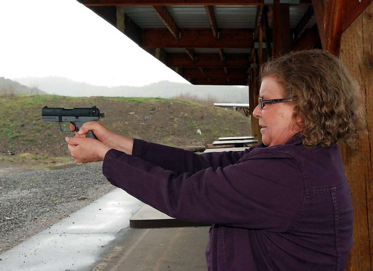 Cynthia Willis shoots her pistol on a firing range March 25, 2011 in White City, Ore. Willis is suing the Jackson County sheriff over denial of a concealed handgun permit after she acknowledged having a medical marijuana card. So far, she has won twice incourt, and is waiting for the Oregon Supreme Court to rule. Willis contends that using marijuana for medicine is no different than using any other prescribed drug, and should not preclude her carrying a concealed handgun for personal protection.
