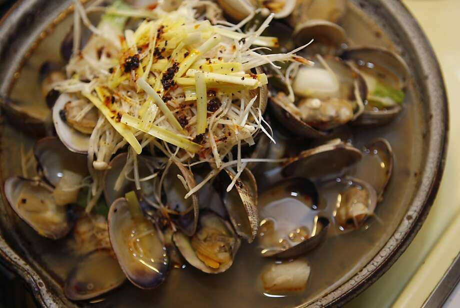 A dish of clams wait to be eaten at the home of Toshihiro and Hiroko Nagano at their home in San Francisco Calif, on Tuesday, March 15, 2011. Photo: Alex Washburn, The Chronicle