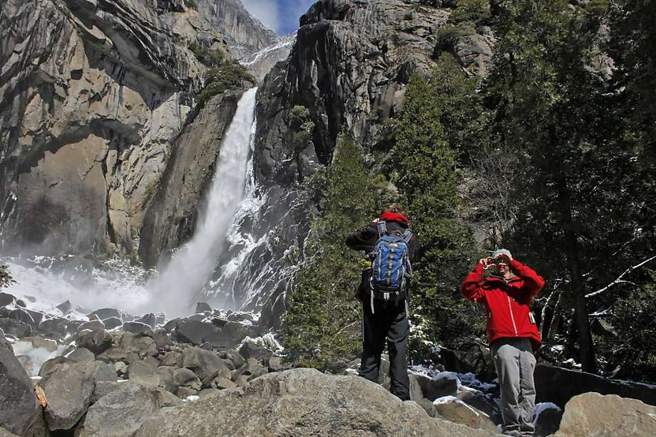 Campers and tourists enjoy themselves looking at the sights of Yosemite Falls at Yosemite National Forest, Saturday April 9, 2011, after thinking that the park may have been closed if the government shutdown, in Yosemite, Calif. Photo: Lacy Atkins, The Chronicle