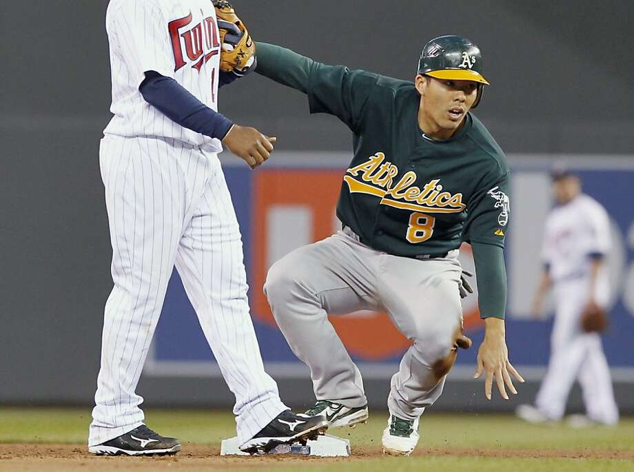 Oakland Athletics' Kurt Suzuki advances to second base on a wild pitch by Minnesota Twins' Nick Blackburn during the sixth inning of a baseball game Saturday, April 9, 2011, in Minneapolis. The Athletics defeated the Twins 1-0. Photo: Genevieve Ross, AP
