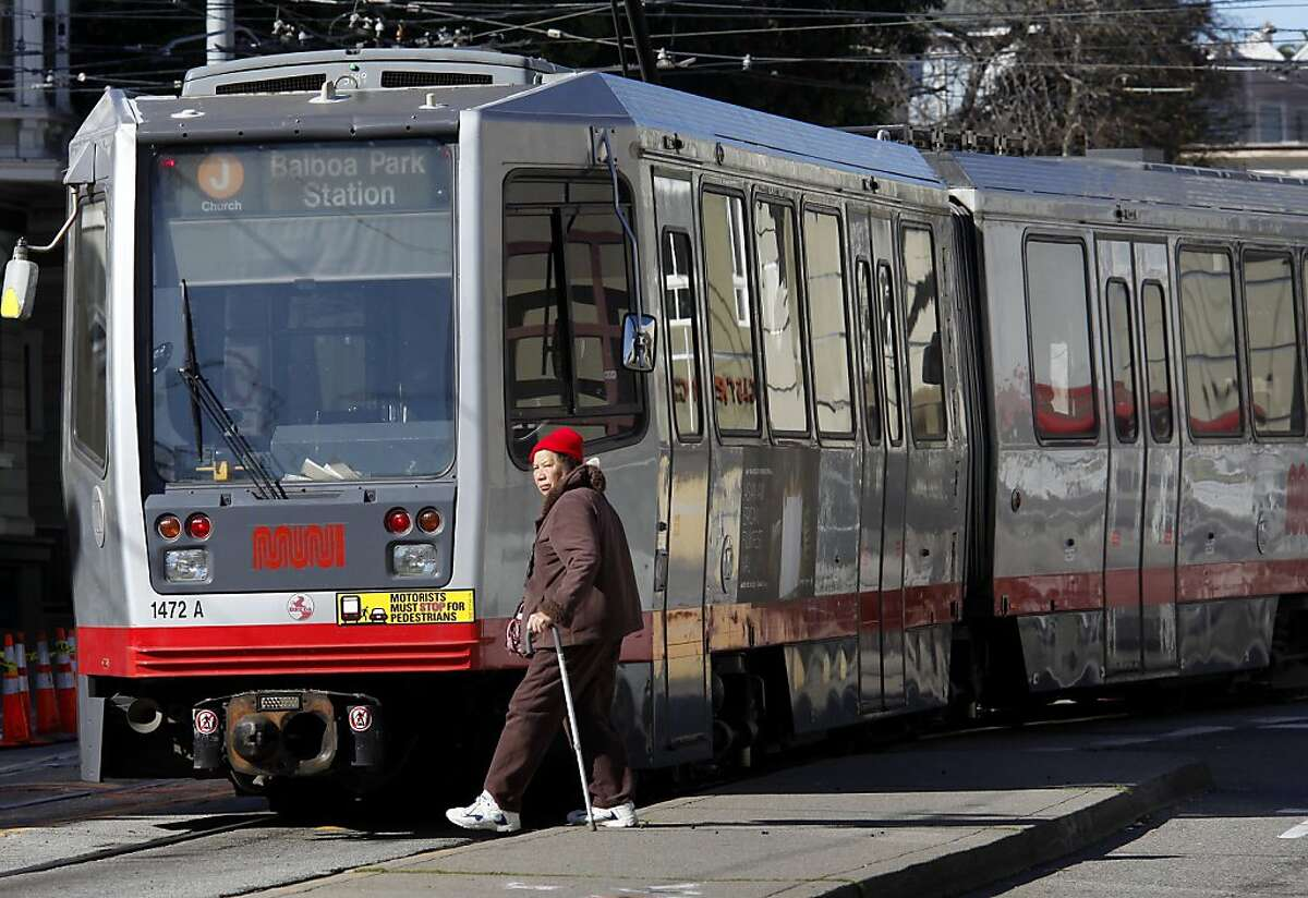 A pedestrian crossed the street near Duboce and Church Streets in San Francisco, Calif., just as a train had passed. Violations found in the MUNI light rail system are among the worst train violations in the state, says the Public Utilities Commission Monday February 28, 2011.
