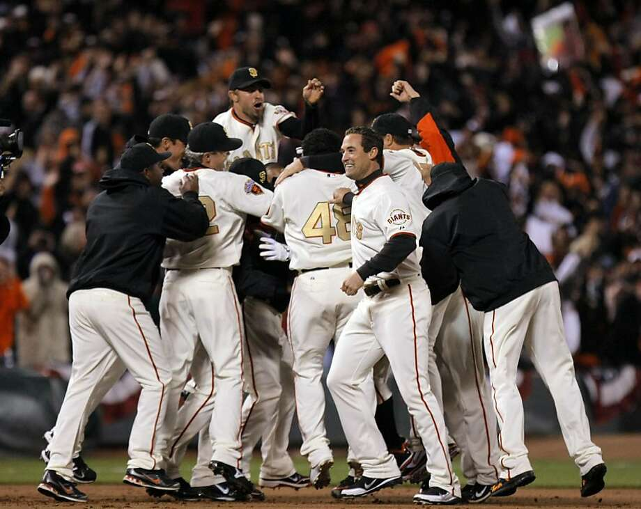 San Francisco Giants Miguel Tejada is greeted by his teammates after his game-winning hit in the bottom of the 9th inning that allowed two runners to score. The Giants won 3-2 over the St. Louis Cardinals Saturday, April 9, 2011 in San Francisco CA Photo: Lance Iversen, The Chronicle