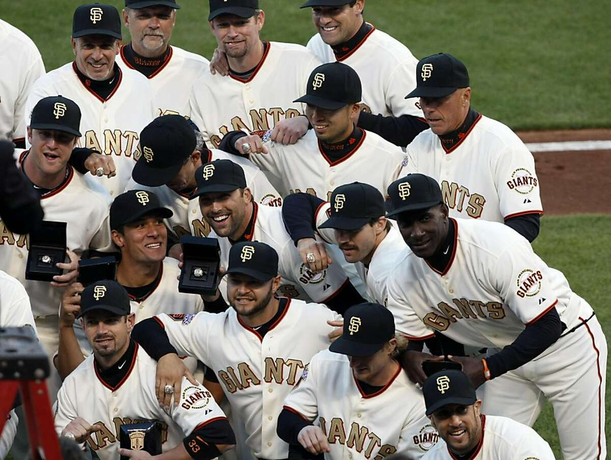 The San Francisco Giants pose for a team portrait after receiving their World Series rings Saturday at AT&T Park.