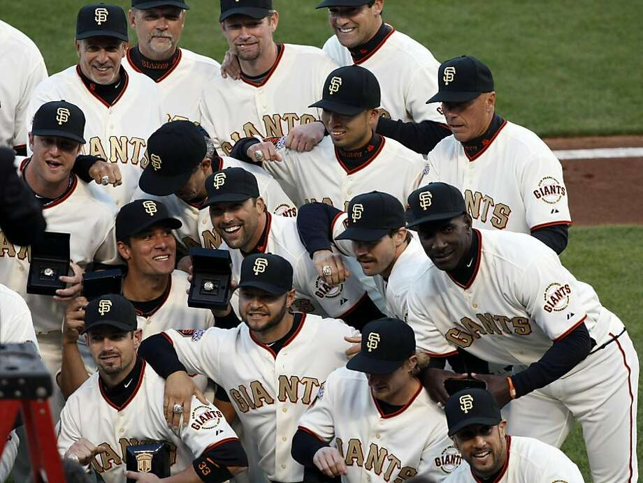 The San Francisco Giants pose for a team portrait after receiving their World Series rings Saturday at AT&T Park. Photo: Lance Iversen, The Chronicle