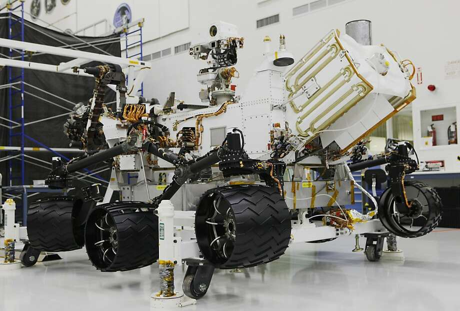 "National Aeronautics and Space Administration, NASA engineers work on ""Curiosity,"" a mega-rover at the Mars Science Laboratory, at the Jet Propulsion Laboratory JPL in Pasadena, Calif., Monday, April 4, 2011. Technicians dressed in protective suits has been working around the clock inside a clean room at the JPL near Los Angeles assembling the craft, testing its science instruments, before shipping it off to Florida for launch later this year. Photo: Damian Dovarganes, AP"