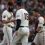 Manager Brian Bochy takes the ball from Brian Wilson after pulling his closer in the ninth inning of the Giants' home opener against the St. Louis Cardinals at AT&T Park in San Francisco on Friday.
