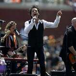 Bay Area band Train performs before the Giants' home opener against the St. Louis Cardinals at AT&T Park in San Francisco on Friday.