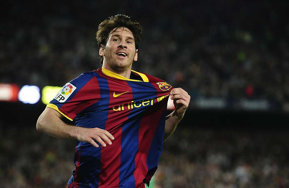 FC Barcelona's Lionel Messi from Argentina reacts after scoring against Almeria during a Spanish La Liga soccer match at the Camp Nou stadium in Barcelona, Spain, Saturday, April 9, 2011. Photo: Manu Fernandez, AP