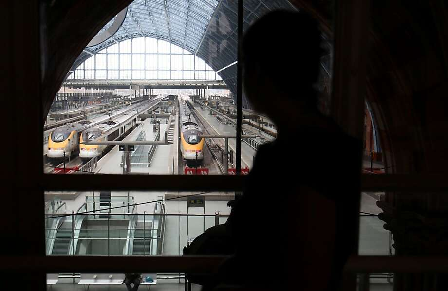 A visitor watches Eurostar trains at St Pancras station from a window at the St Pancras Renaissance Hotel in London, U.K., on Tuesday, March 29, 2011. Photo: Simon Dawson, Bloomberg
