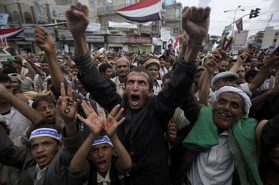 Anti-government protestors shout slogans during a demonstration demanding the resignation of Yemeni President Ali Abdullah Saleh, in Sanaa, Yemen, Wednesday, April 13, 2011. Yemen has been wracked by protests since mid-February demanding President Ali Abdullah Saleh resign because of the country's lack of freedoms and extreme poverty. More than 120 people have been killed since the uprising began on Feb. 11, inspired by popular uprisings in Tunisia and Egypt. Photo: Muhammed Muheisen, AP