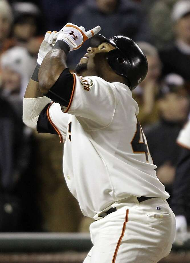 San Francisco Giants' Pablo Sandoval gestures crossing home plate after hitting a home run off Los Angeles Dodgers starting pitcher Ted Lilly during the sixth inning of their baseball game in San Francisco, Wednesday, April, 13, 2011.  San Francisco won the game 4-3. Photo: Eric Risberg, AP