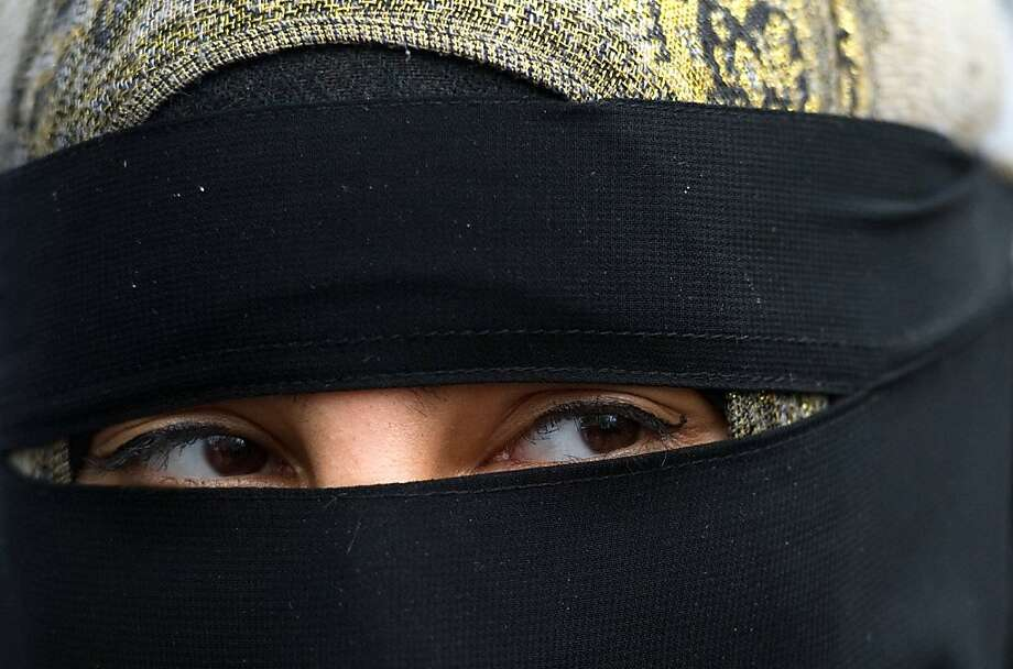 TOPSHOTS A Protestor demonstrates outside the French embassy in central London over the introduction of a ban on the wearing of veils in France on April 11, 2011. France is the first country in Europe to publicly ban a form of dress some Muslims regard asa religious duty.  Anyone caught breaking the law will be liable to a fine of 150 euros (£133; $217) and a citizenship course.  TOPSHOTS / Photo: Leon Neal, AFP/Getty Images
