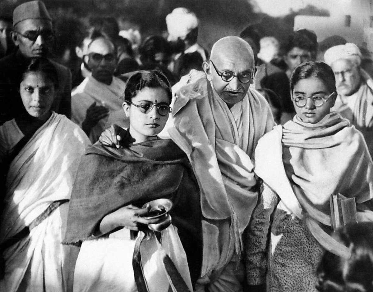 FILE -In this January 1948 file photo, Mahatma Gandhi rests his arms on shoulders of two disciples. A state in western India banned Pulitzer-Prize winning author Joseph Lelyveld's new book about Mahatma Gandhi on Wednesday, March 30, 2011, after reviews saying it hints that the father of India's independence had a homosexual relationship.