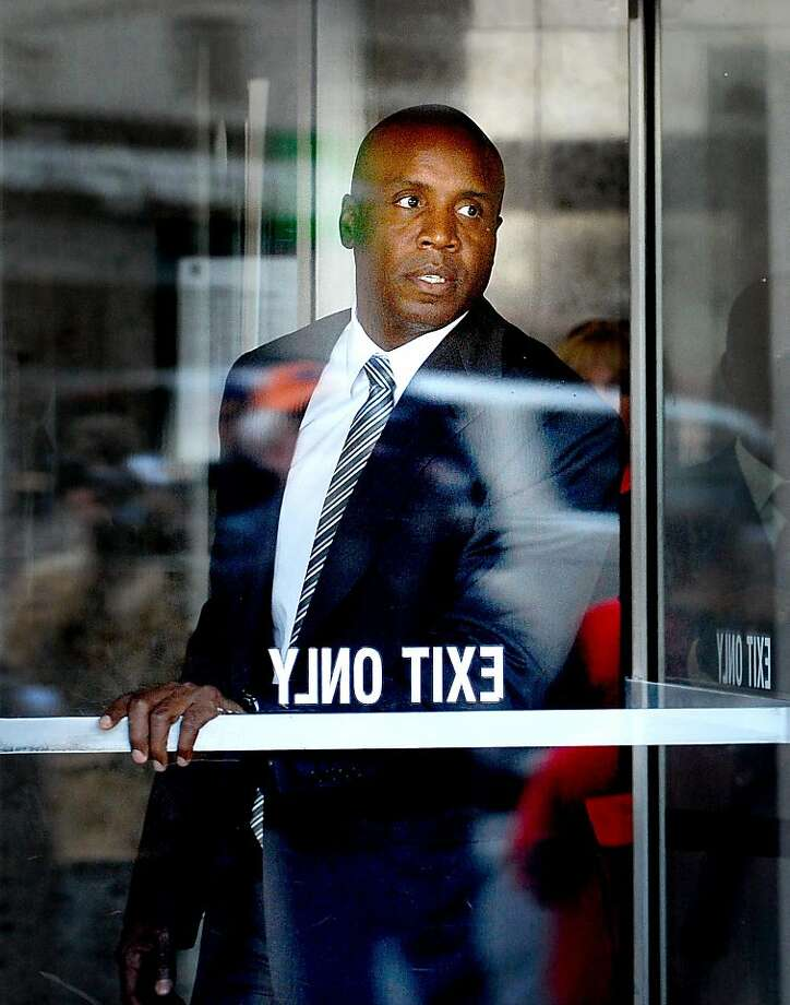 Barry Bonds leaves federal court on Friday, April 8, 2011, in San Francisco. A jury is deliberating whether the former Giants player is guilty of perjury in connection with a steroids investigation. Photo: Noah Berger, Special To The Chronicle