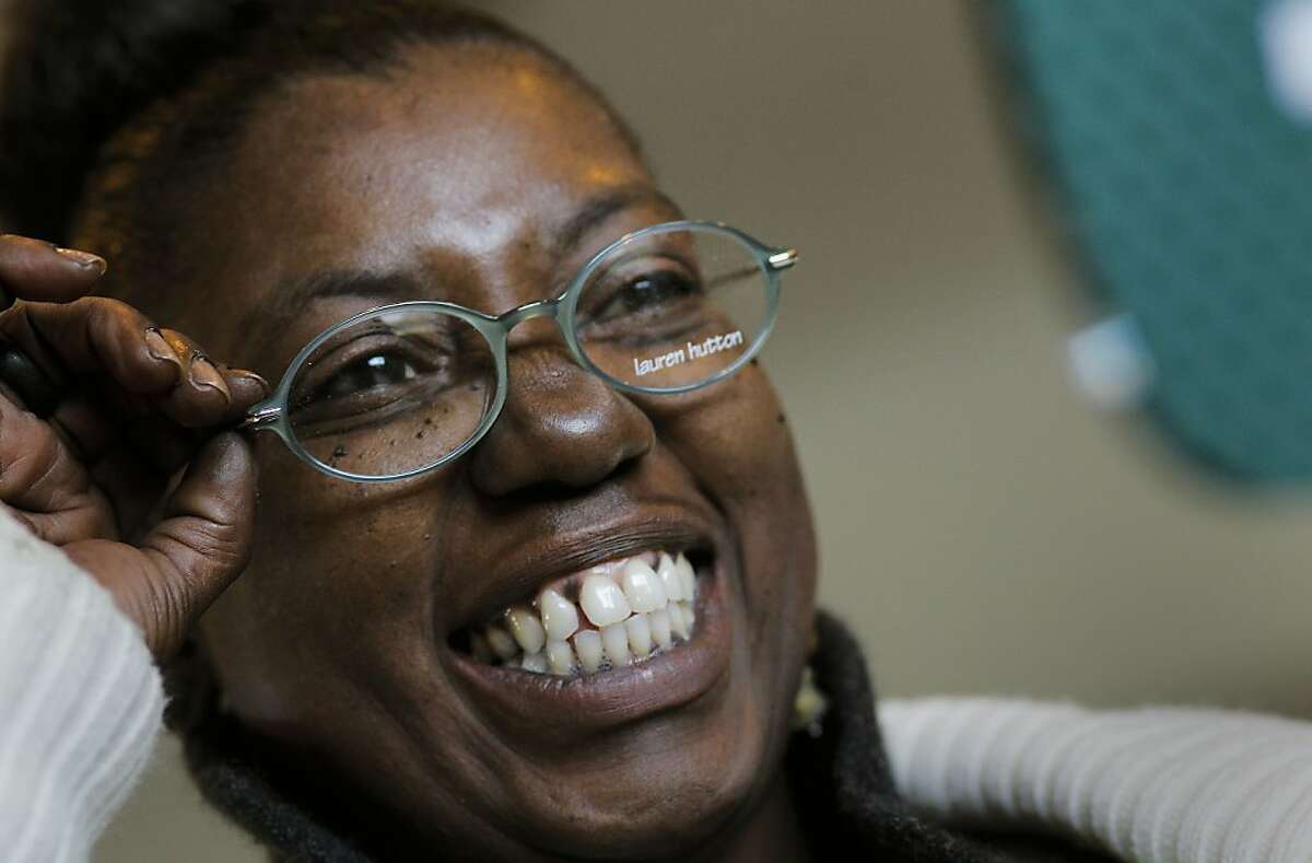 Eurisa Phillips of Point Richmond is all smiles as she picks out a new pair of glasses after her eye exam, as RAM, Remote Area Medical, holds their free clinic, offering services in dental, vision and general medicine at the Oakland Alameda County Coliseum, in Oakland, Ca. on Saturday Apr. 10, 2011.