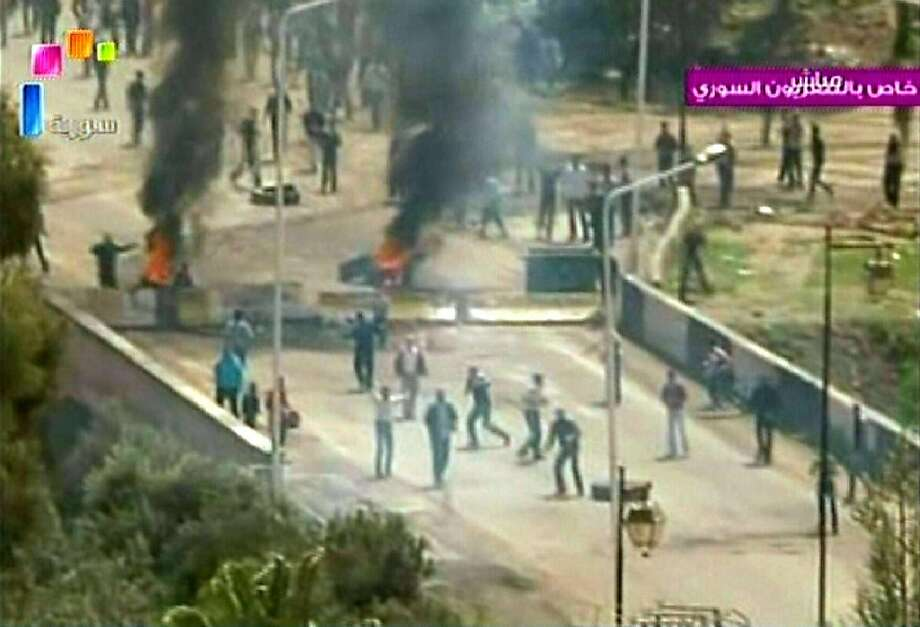 """RESTRICTED TO EDITORIAL USE - MANDATORY CREDIT """"AFP PHOTO / SYRIAN TV"""" - NO MARKETING NO ADVERTISING CAMPAIGNS - DISTRIBUTED AS A SERVICE TO CLIENTS An image grab taken from footage broadcast by the Syrian state television allegedly shows scenes of clashes in the flashpoint town of Daraa on April 8, 2011. Syrian security forces shot dead at least three protesters in Daraa, activists said as thousands rallied for democracy for the fourth week after Muslim prayers. Photo: -, AFP/Getty Images"""