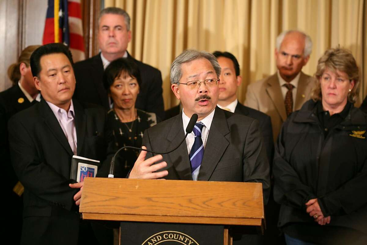 San Francisco Mayor Ed Lee along with representatives for Boxer's and Feinstein's offices, the Director of Emergency Management the president of the Board of Supervisor's, the chief of police and others as he speaks about the devastating 8.9 earthquake in Japan and the Tsunami waves along the California coast at City Hall Mayor's Office in San Francisco, Calif. on Monday, April 11, 2011. Kat Wade / Special to the Chronicle