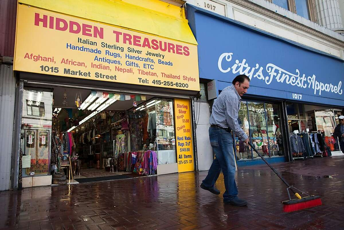Eddy Faiez owner of Hidden Treasures cleans the sidewalk in front of his store on Market Street April 1, 2011 in San Francisco, Calif. Photograph by David Paul Morris/Special to the Chronicle