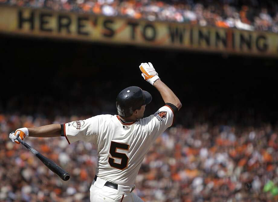 The Giants' Pat Burrell hits a solo home run in the sixth inning of the San Francisco Giants' home opener against the St. Louis Cardinals at AT&T Park in San Francisco on Friday. Photo: Michael Macor, The Chronicle