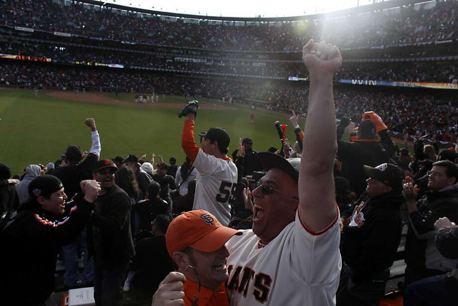 Season ticket holder Alexi Arvanitidis and Michael Woods go crazy after the Giants win the home opener against the St. Louis Cardinals in extra innings Friday in San Francisco. Photo: Mike Kepka, The Chronicle
