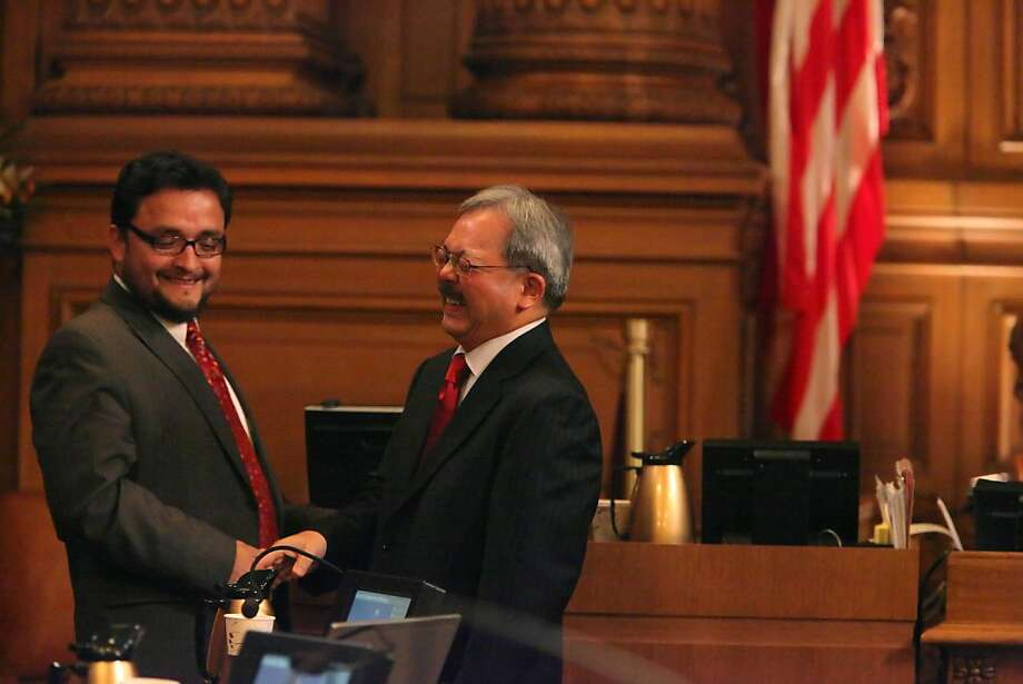 San Francisco Mayor Ed Lee (right) shares a laugh with Supervisor David Campos as he shakes his hand after he answered 5 questions from the Board of Supervisors during Formal Policy Discussions at City Hall on Tuesday, April 12, 2011 in San Francisco, Calif. Photo: Lea Suzuki, The Chronicle