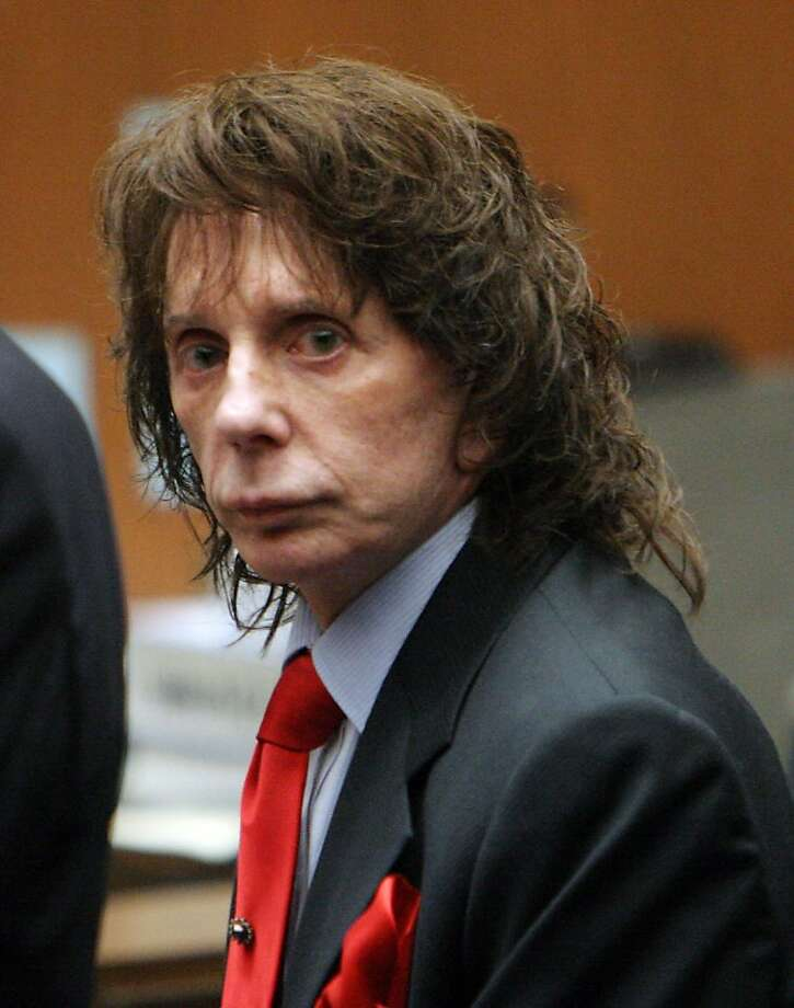 LOS ANGELES, CA - APRIL 13:  Phil Spector looks at the jury as it they arrive before the verdict was read at Los Angeles Criminal Courts April 13, 2009 in Los Angeles, California. Spector was found guilty of second degree murder during the re-trial in the shooting death of actress Lana Clarkson six years ago.  (Photo by Al Seib-Pool/Getty Images) Photo: Pool, Getty Images