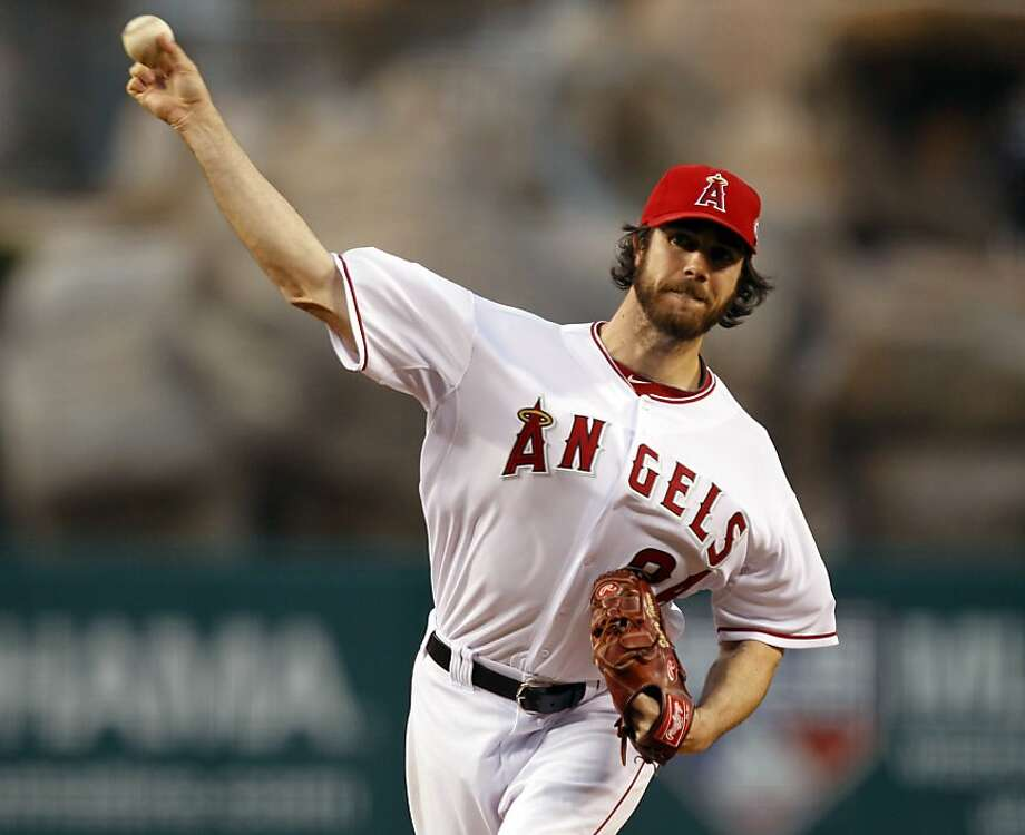 Los Angeles Angels starter Dan Haren pitches against the Cleveland Indians during the first inning of a baseball game in Anaheim, Calif., Tuesday, April 12, 2011. Photo: Alex Gallardo, AP
