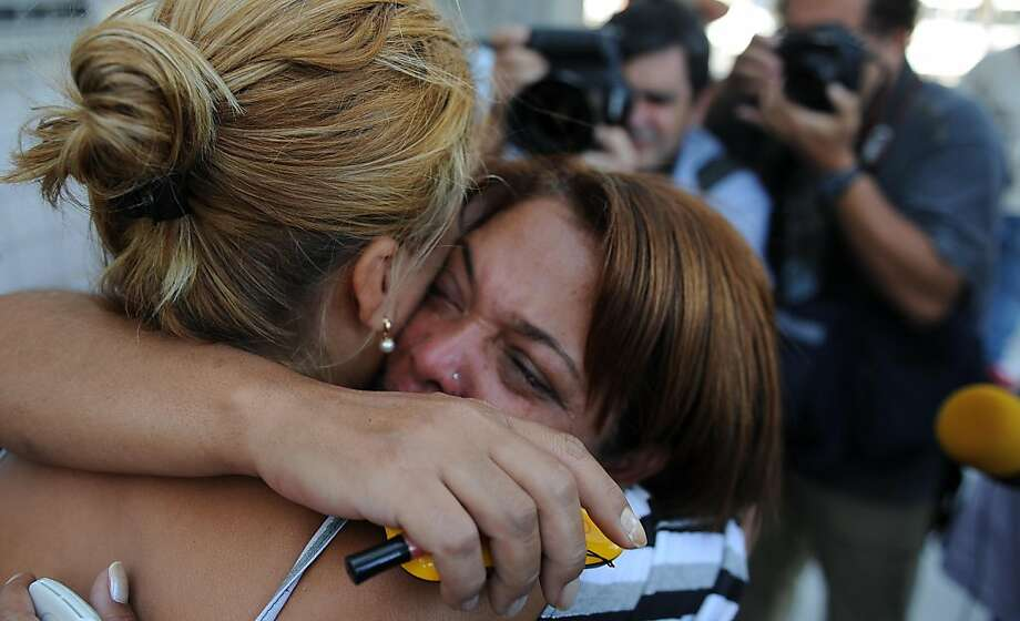 Relatives of the victims of a school shooting in Rio de Janeiro cry as they wait for the Forensic Medicine Institute to release the bodies of their loved ones, on April 7, 2011. A heavily armed man entered his former Rio school and opened fire, killing 10children and wounding 18 people before taking his own life, officials said in a tragedy that has shaken Brazil.  TOPSHOTS/ Photo: Vanderlei Almeida, AFP/Getty Images