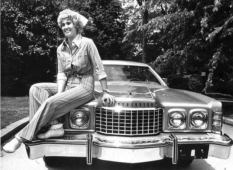 "Tammy Wynette sits on the hood of a car in a May 11, 1976 file photo. This year's selections for the National Recording Registry include Tammy Wynette's 1968 country song that divided American women with the message, ""Stand By Your Man,"" the library announced Wednesday April 6, 2011. Photo: Nancy Rhoda, AP"