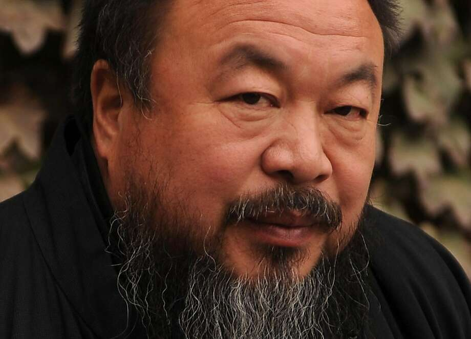 (FILES) This file picture taken on November 7, 2010 shows Chinese artist Ai Weiwei in the courtyard of his home in Beijing where he remains under house arrest. Outspoken Chinese artist Ai Weiwei, the latest activist detained in a broad crackdown on dissent, is under investigation for suspected economic crimes, state media said on April 7, 2011. Photo: Peter Parks, AFP/Getty Images