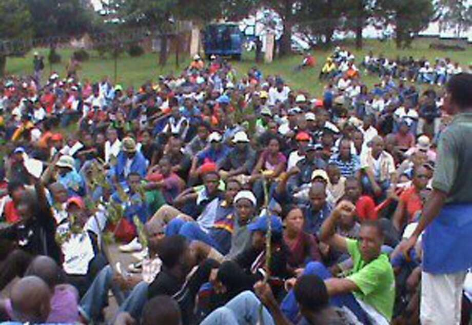 In this photo supplied by Swaziland Solidarity Network protesters gather  to protest  in Manzini, Swaziland Tuesday April 12, 2011 before being dispersed by police. A spokesman for the Swaziland National Association of Teachers (SNAT) said that police fired water canons and teargas and beat people with their batons to disperse the more than 1,000 workers who were singing and chanting at a teacher's training  center as they prepared to march to the city's Freedom Square. The march never got underway. Photo: AP