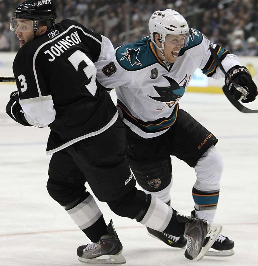 Los Angeles Kings defenseman Jack Johnson, left, and San Jose Sharks center Joe Pavelski vie for the puck during the first period of an NHL hockey game Thursday, March 24, 2011, in Los Angeles. Photo: Jason Redmond, AP