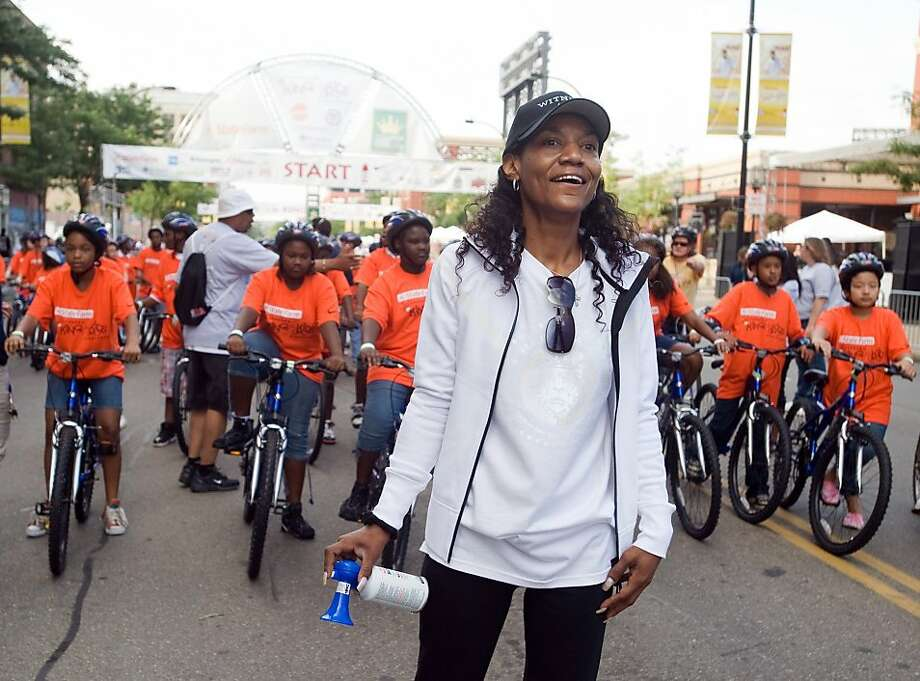 """FILE - This Aug. 22, 2009, file photo shows Gloria James, mother of basketball star LeBron James, watching a group of bike riders as she waits to start another group of riders at the """"King for Kids Bikeathon"""" in Akron, Ohio. Miami Beach police spokeswomanDeborah Doty confirmed that Gloria James was arrested at the Fontainebleau Hotel early Thursday morning, April 7, 2011. She would not say what led to the 4:47 a.m. arrest, or what charges Gloria James may face. Photo: Phil Long, AP"""