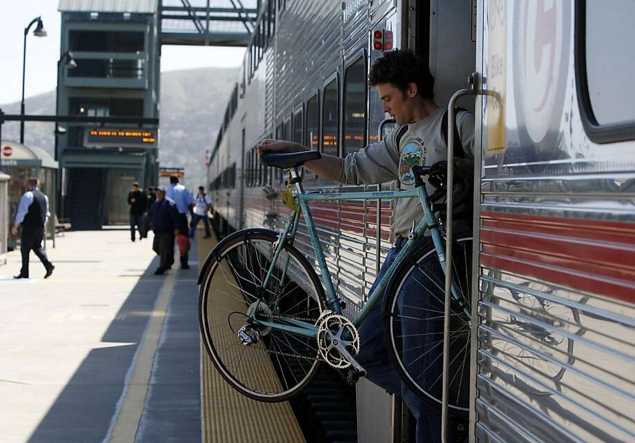 A passenger (name unknown) exits a Northbound train at Bayshore station on Wednesday, April 6, 2011. Bayshore station at 400 Tunnel Road in San Francisco will be closed as part of Caltrain's funding plan requiring fare increases without service cuts. Photo: Anna Vignet, The Chronicle