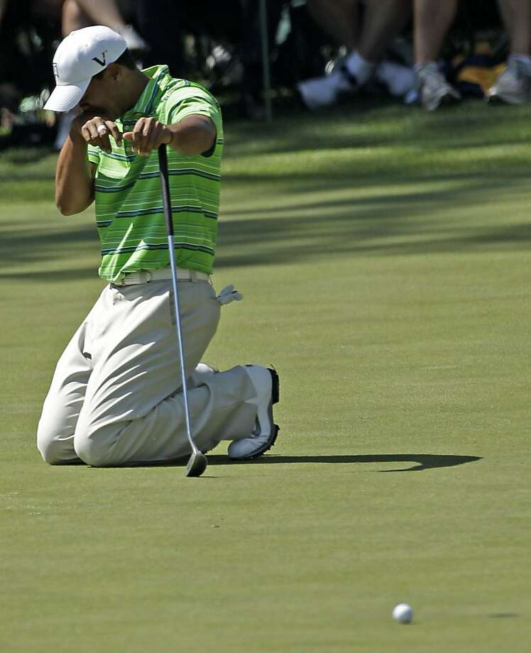 Tiger Woods reacts after he misses a birdie putt on the 16th hole during the first round of the Masters golf tournament Thursday, April 7, 2011, in Augusta, Ga. Photo: David J. Phillip, AP