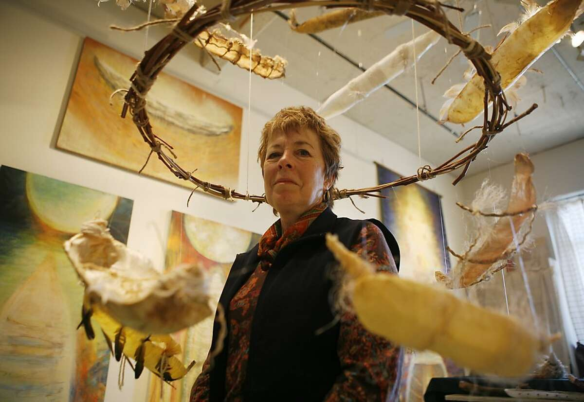 San Francisco artist Jennifer Ewing poses with the ethereal spirit boats she makes using halved plastic bottles. She started making the boats after her father died, as a way to express the journey of loss, grief and acceptance.