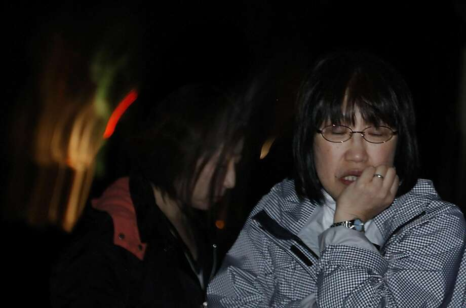 A Japanese woman reacts Friday, April 8, 2011 in Ishinomaki, Iwate Prefecture, northern Japan, after a 7.4-magnitude earthquake struck offshore, late Thursday. Photo: Vincent Yu, AP