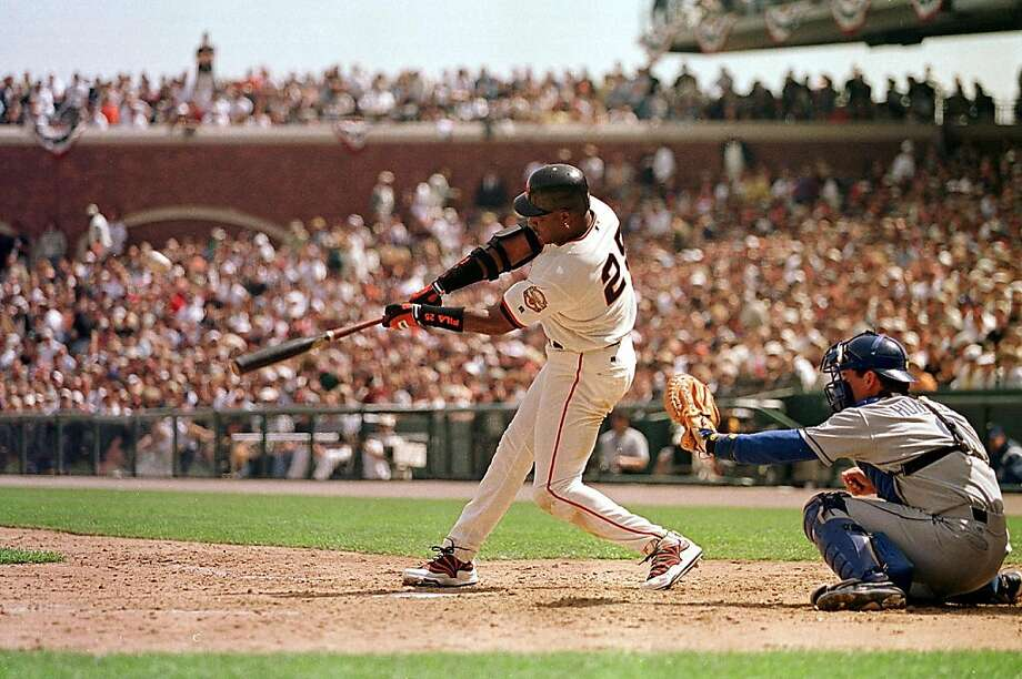 SAN FRANCISCO, UNITED STATES:  San Francisco Giant slugger Barry Bonds launches a solo homerun into center field off Los Angeles Dodgers starting pitcher Chan Ho Park of Korea during the third inning 11 April, 2000, in San Francisco. It was the Giants Opening Day at their new home Pacific Bell Park. Photo: John G. Mabanglo, AFP/Getty Images