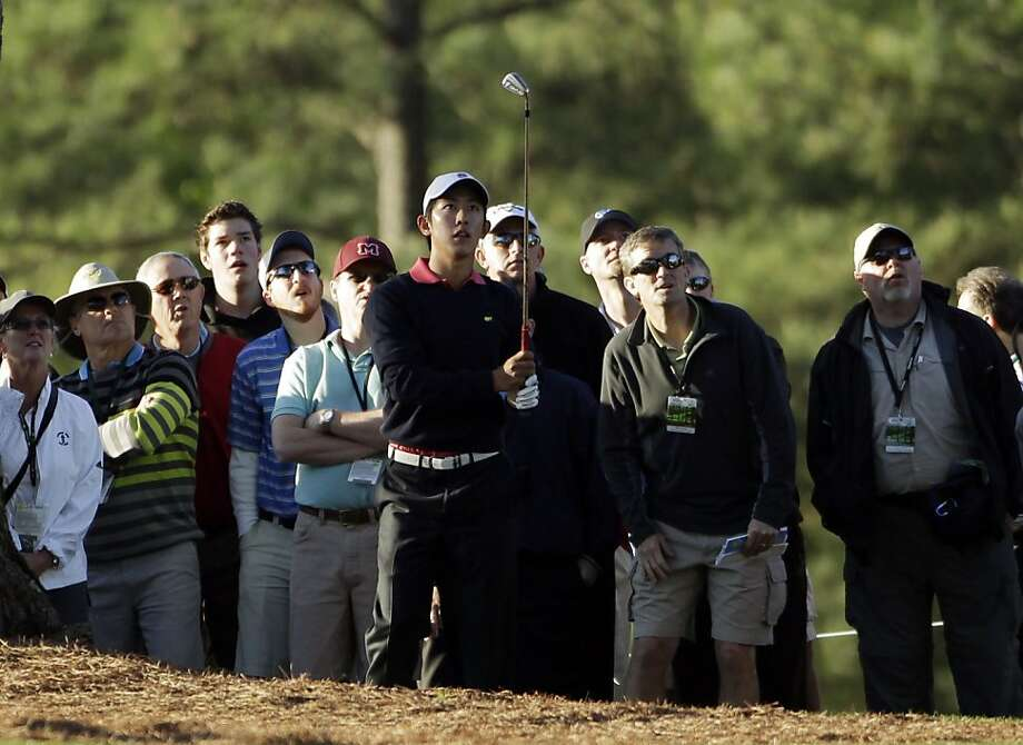 David Chung watches his shot out of the rough off the first fairway during the first round of the Masters golf tournament Thursday, April 7, 2011, in Augusta, Ga. Photo: David J. Phillip, AP