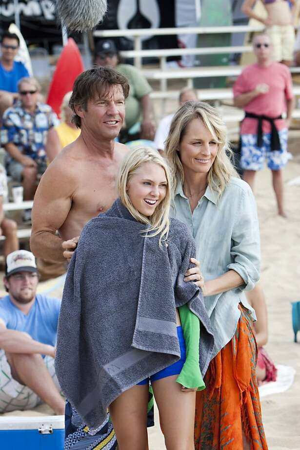 """In this film publicity image released by TriStar Pictures, Dennis Quaid, AnnaSophia Robb, center, and Helen Hunt are shown in a scene from """"Soul Surfer."""" Photo: Mario Perez, AP"""