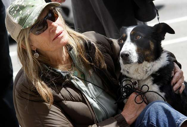 Sandra Willingham and her dog Syringa listened to speakers on the dog issue. A large gathering of dog owners on the steps of San Francisco City Hall Monday April 11, 2011 preceded a meeting of the Board of Supervisors. The dog owners are upset with the Golden Gate National Recreation Area plan to cut or ban dogs in specific areas of the park. Photo: Brant Ward, The Chronicle