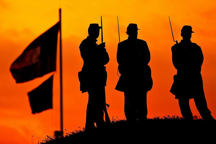 CHARLESTON, SC - APRIL 12:  Confederate re-enactors stand on the ramparts of Fort Moultrie are silhouetted in the rising sun to mark the 150th anniversary of the Civil War on April 12, 2011 in Charleston, South Carolina.  The first shot that began the Civil War was fired at Fort Sumter April 12, 1861 in Charleston harbor.  (Photo by Richard Ellis/Getty Images) *** BESTPIX *** Photo: Richard Ellis, Getty Images