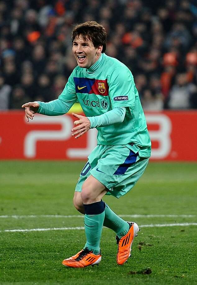 DONETSK, UKRAINE - APRIL 12:  Lionel Messi of Barcelona celebrates scoring the opening goal during the UEFA Champions League Quarter Final 2nd Leg match between Shakhtar Donetsk and Barcelona, at the Donbass Arena on April 12, 2011 in Donetsk, Ukraine. Photo: Laurence Griffiths, Getty Images