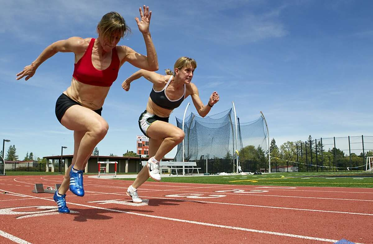Joy Upshaw (left) and Debbie Deutsch train together on the track at Gunn High School in Palo Alto, Calif., on Wednesday, March 30, 2011. Upshaw, who just turned 50, has already set two world records in the long jump and 200 in the 50 and over age group for Master's Track.