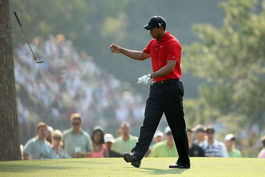 AUGUSTA, GA - APRIL 10:  Tiger Woods tosses his golf club on the 17th hole during the final round of the 2011 Masters Tournament at Augusta National Golf Club on April 10, 2011 in Augusta, Georgia. Photo: Andrew Redington, Getty Images
